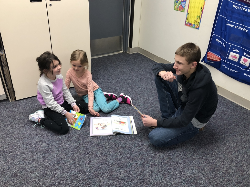 Reading to the kindergartens.