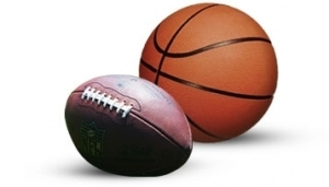 An orange basketball and a regular football