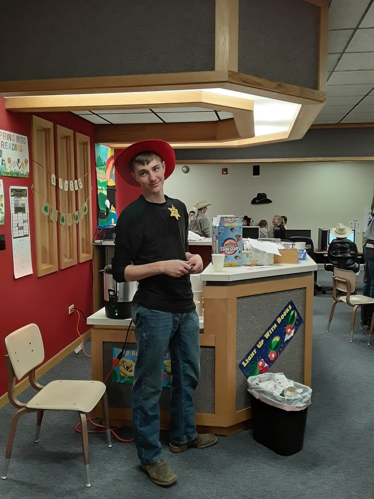 Student with read cowboy hat