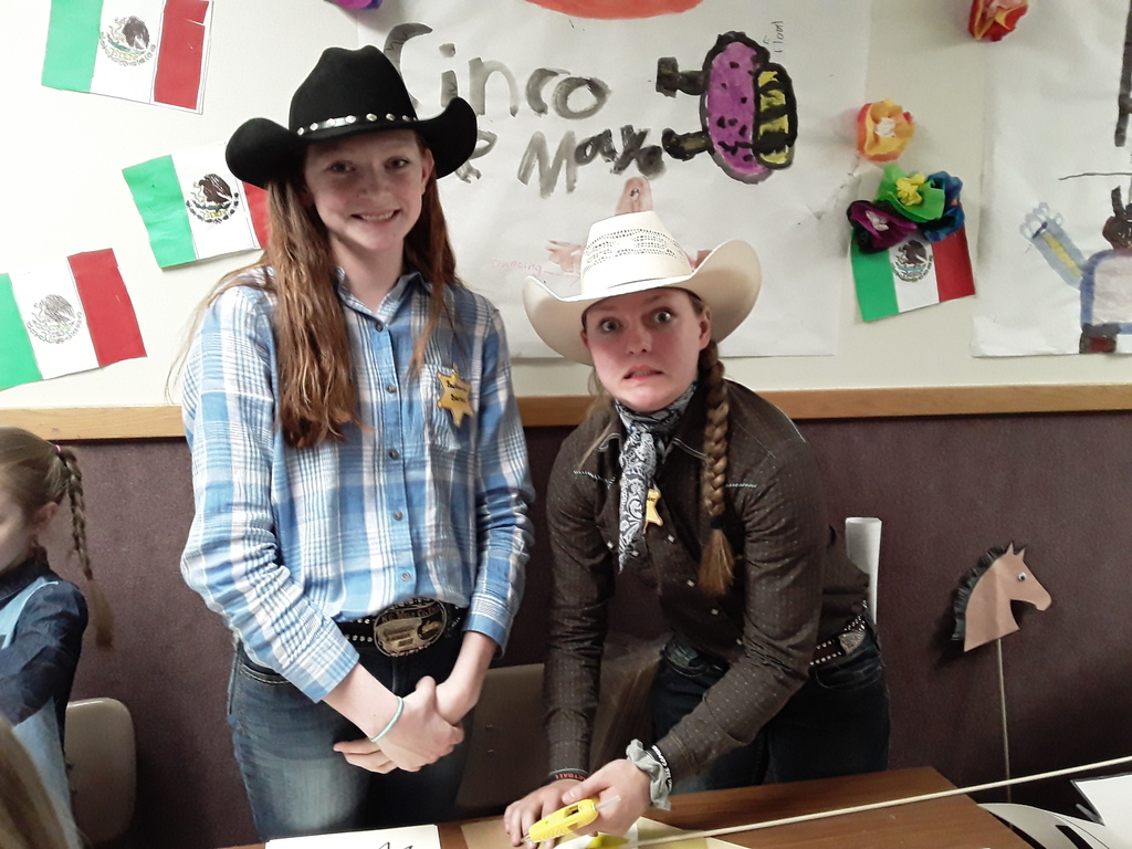 two students dressed up as cowgirls